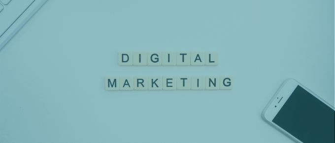 """desktop with a cell phone and the words """"digital marketing"""""""